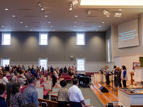 Musicians leading congregation in singing
