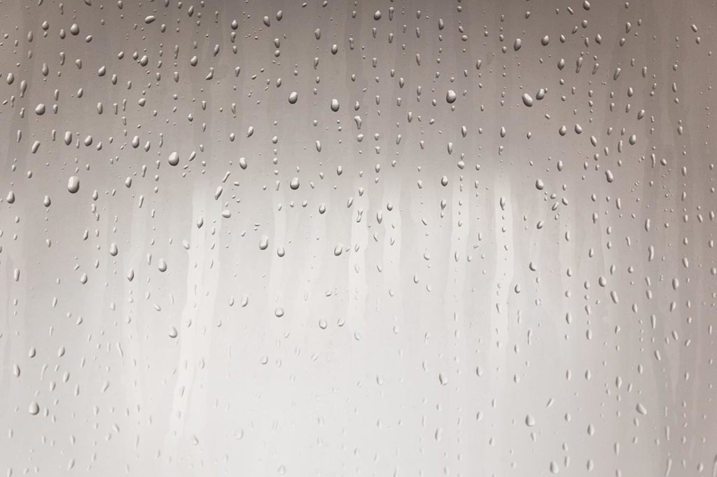 Water droplets on shower wall